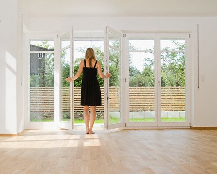 Woman Standing in Empty House