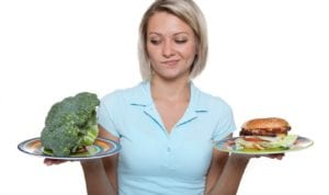 woman choosing healthy over junk