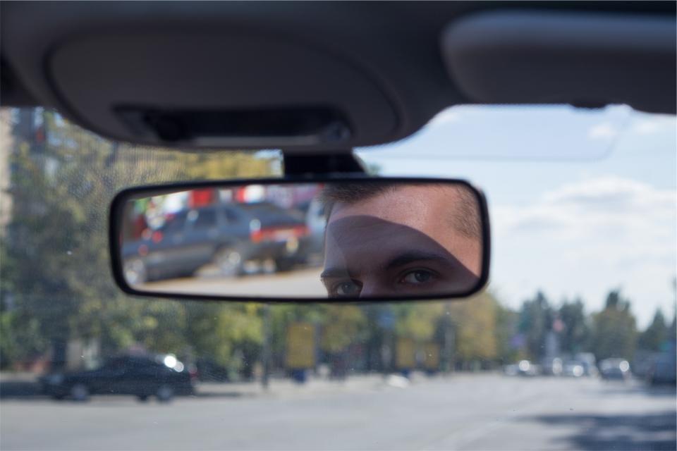 looking in rearview mirrir