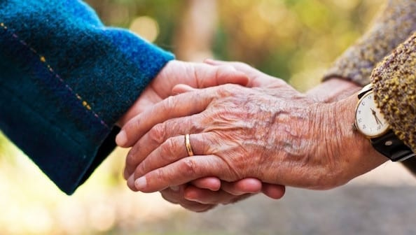 Old couple holding hands